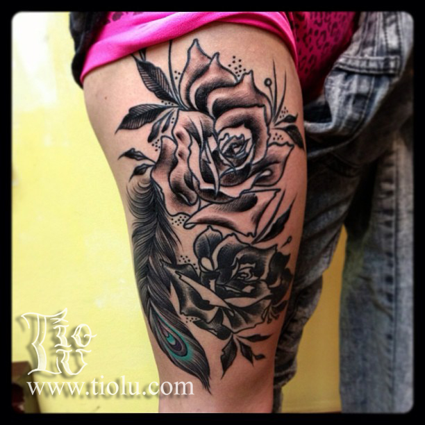 Black roses with peacock feather