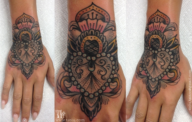 Heart hand job tattoo